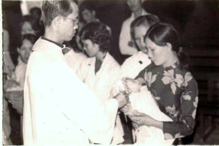 Hoang being baptized 001.jpg