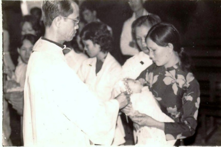 Hoang being baptized 001.jpg